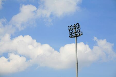 Stadium spotlight pole with blue sky