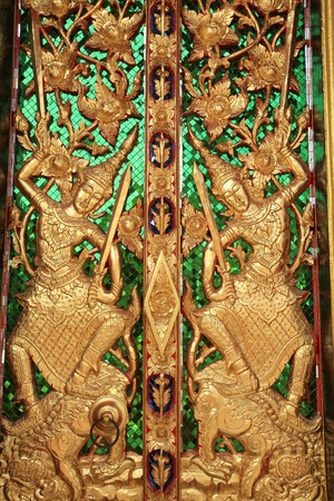 Ornament: detailed sculpture of gold god on temple gate Stock Photo - 11491582