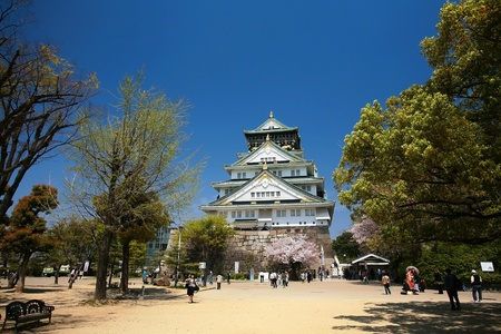 Osaka castle with beautiful nature and blue sky
