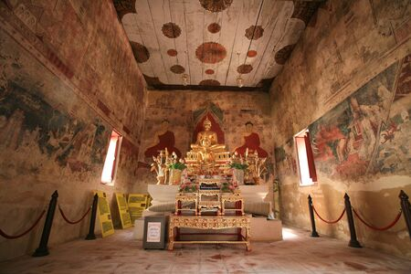 nonthaburi province: Ornament: Buddha statue with interior ancient painting inside temple at Chomphuwek wat in Nonthaburi province, Thailand Editorial