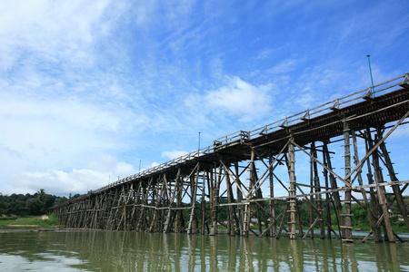 Travel landscape: Mon wooden bridge against blue sky at Sangklaburi, Thailand