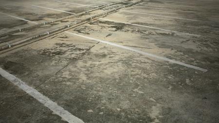 Background: Empty grunge parking lot