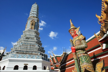 Ornament: red giant guardian and shrine architecture at Wat Phra Kaew in Bangkok, Thailand