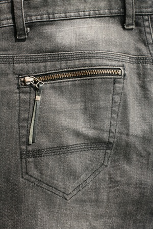 Detailed Texture: back pocket with zipper of black jeans  photo