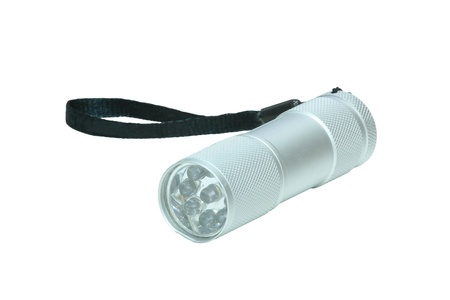 Background: small silver flashlight isolated on white cutout