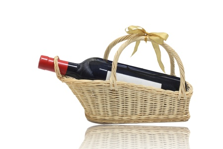 Background: isolated wine bottle with blank label on present basket Stock Photo