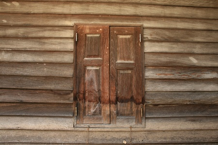 Textured background: wooden pattern of window and wall on traditional thai house