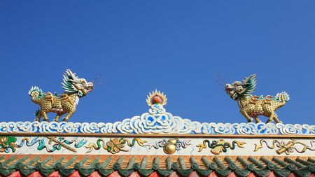 Ornament: small dragon status on chinese temple roof photo
