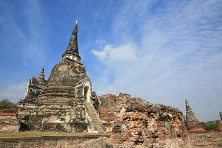 Ornament: ancient pagoda near ruined brick wall against blue sky at wat Phra Sri Sanphet, Ayutthaya, Thailand Stock Photo - 11972890