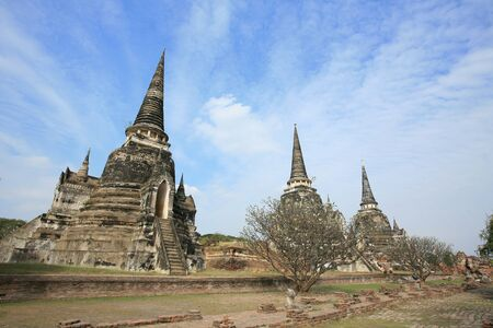 Ornament: Three ancient pagodas against blue sky at wat Phra Sri Sanphet, Ayutthaya, Thailand