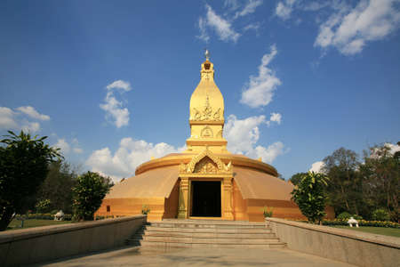 Ornament: landscape of golden pagoda with natural environment at wat Nong Pah Pong  in Ubon Ratchathani province, Thailand photo