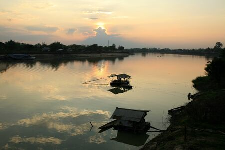 Silhouette background: river landscape scene with rafts at dusk ped Stock Photo - 12105307