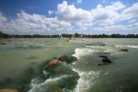 Background: beautiful view of flowing water through rock at Kang Sapue, Ubon Ratchathani province, Thailand photo