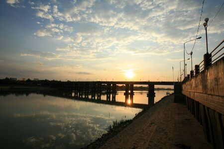 Background: bridge landscape with water reflection before sunset at Ubon Ratchathani province, Thailand Stock Photo - 12305691