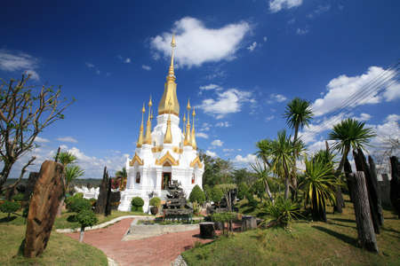Ornament: beautiful white and gold pagoda architecture at wat Tham Kuha Sawan at Ubon Ratchathani province, Thailand photo