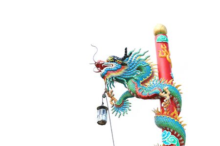 Ornament: isolated chinese dragon attached on red column with white background photo