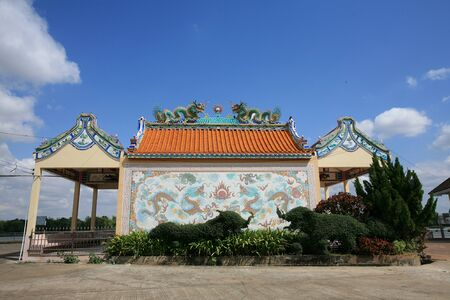Ornament: chinese temple architecture against blue sky photo
