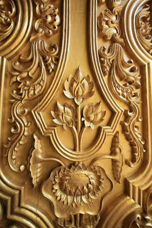 Ornament: pattern of gold lotus sculpture on the temple door Stock fotó