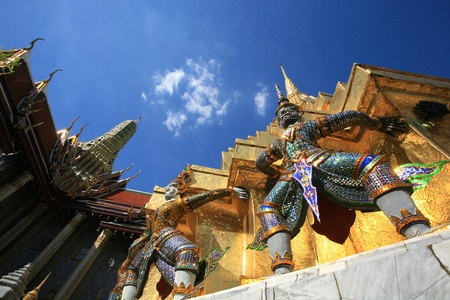 venerate: Ornament  hanuman statues attached on gold pagoda surface at Wat Phra Kaew, Thailand  Stock Photo
