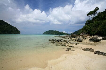Travel background  beautiful beach and natural stones against blue sky at Surin islands national park, Thailand photo