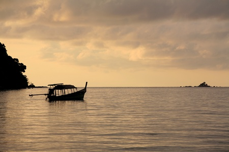 long tailed boat: Silhouette background  tranquil scene of long-tailed boat on the sea at dawn