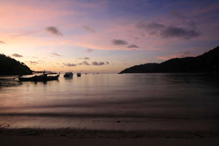 Travel background  silhouette scene of tropical beach before sunrise at Surin islands national park, Thailand Stock Photo - 12686216