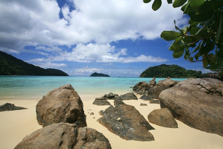 Travel background  natural stones and beautiful tropical coastline against blue sky and cloud at Surin islands national park, Thailand photo