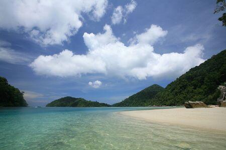 Travel destination  beautiful shore and transparent blue sea against blue sky at Surin islands national park, Thailand photo