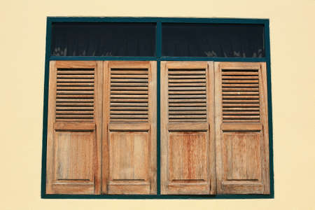 Background  vintage wooden windows on cement wall photo