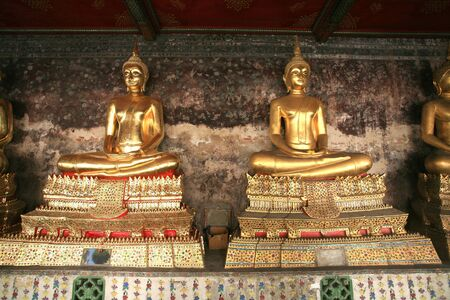 Ornament  two gold buddha statues located in front of old painting wall Stock Photo - 13220797