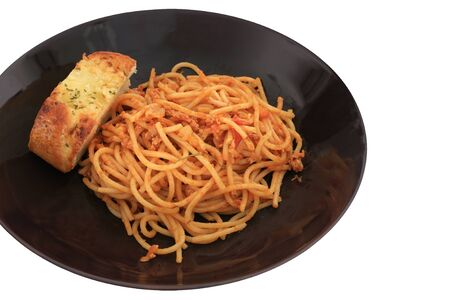 Italian food   fresh spaghetti with tomato sauce and pork serving with garlic bread isolated on white Stock Photo - 13342939