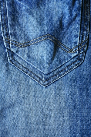back pocket: Textured background  closeup back pocket of blue denim male jeans
