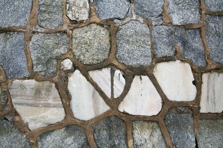 Textured pattern  closeup of stone wall exterior photo