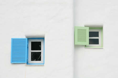 Vintage blue and green open windows on the wall photo