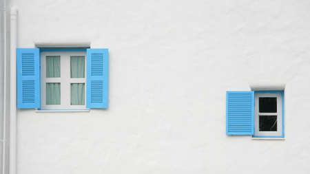Vintage blue open windows on the wall photo