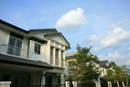 Closeup modern houses at second floor against blue sky photo
