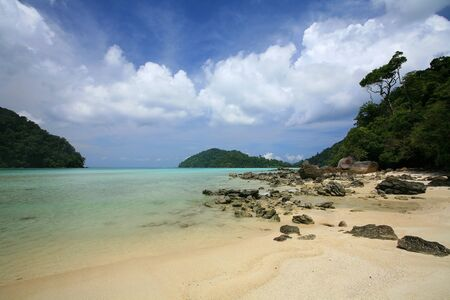 Beautiful beach and natural stones against blue sky at Surin islands national park, Thailand Stock Photo - 13889168