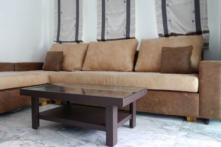 Big brown sofa and small table at living room photo
