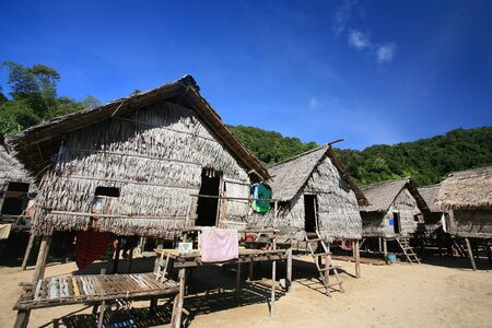 Sea Gypsy, Morgan, wooden houses against blue sky at Surin islands national park, Thailand