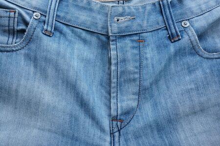 Textured pattern  closeup front men bleach blue jeans Stock Photo