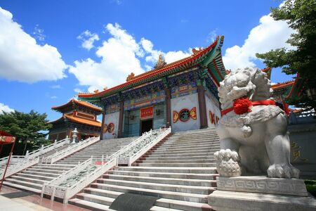 nonthaburi province: Lion statue located in front of Chinese temple, wat Leng-Noei-Yi against blue sky in Nonthaburi province, Thailand