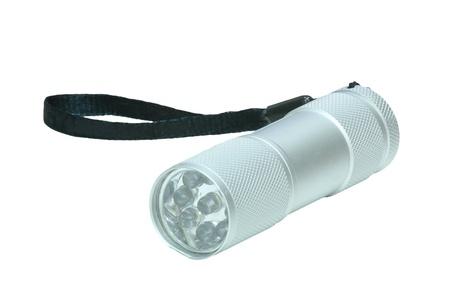 Mini aluminum flashlight isolated on white photo