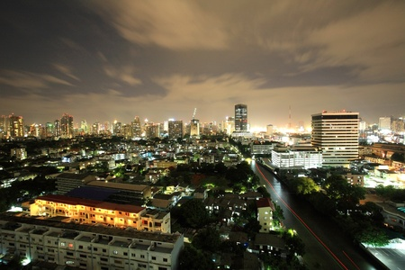 Aerial cityscape view of Bangkok downtown building and village near the canal  photo
