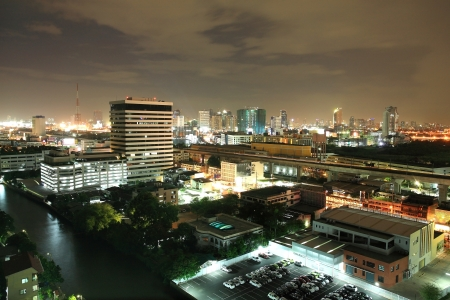 Aerial night scene of Bangkok downtown cityscape near the canal