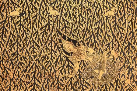 Gold sculpture interior of angel and rabbits on temple wall at wat Chaloem Phra Kiat in Nonthaburi, Thailand photo