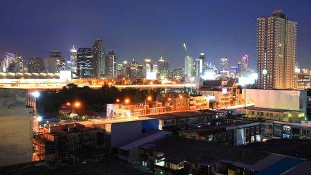 Aerial view of Bangkok downtown cityscape of high tower building near airport link photo