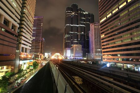 BANGKOK -JUL 07  night scene of BTS sky railway surrounded by high modern towers at Chong Nonsi Transit Station on 07 July 2012 in Bangkok,Thailand