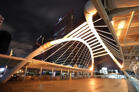 BANGKOK -JUL 07  night landscape of Pedestrian Bridge to connect between Sky Transit System and Bus Rapid Transit System at Sathon junction on 07 July 2012 in Bangkok,Thailand Stock Photo - 14423219