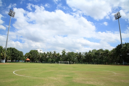 kickoff: Kickoff Center to the goal of the soccer field against blue sky