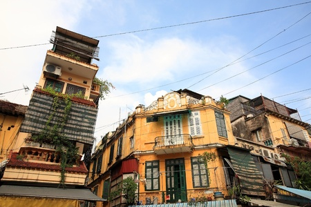 Vintage yellow buildings in europe style against blue sky in Hanoi downtown, Vietnam photo
